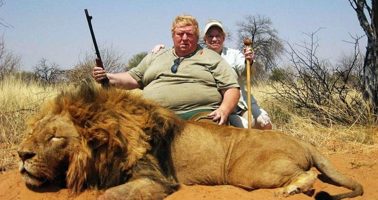 Trophy hunter with lion